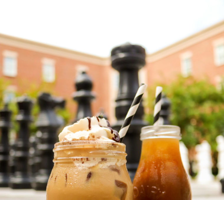 Iced coffee beverages sitting near the giant chess set in the Wanek building